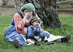 woman crying and her baby